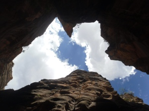 Zion National Park, Zion Narrows in Utah, slot canyon walls and sky, photo by Timothy Tiernan